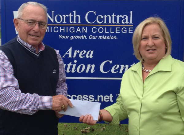 Bud Darnell, President of the Cheboygan Communities Foundation presents the first installment support of $5,000 to Linda Nuess, President of the Cheboygan Economic Development Group, who is sponsoring the introduction of Digital Works to the community.