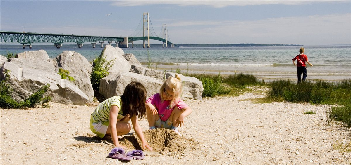 Playing on the beach in Mackinaw